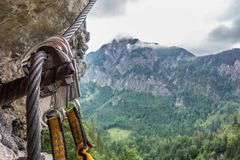 View of the rocks, via ferrata in Salzkammergut, Austria. The Ferrata set is secured on a metal rope. Safe locking. In the background are rocks in the cloud Stock Images