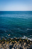 View of a rocky beach in Malibu, California. Stock Images