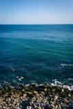 View of a rocky beach in Malibu, California. View of a rocky beach in Malibu, California Stock Images