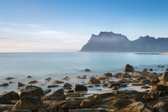 A view of the rocky beach Uttekleiv Lofoten. Blurry effect of water surface with long exposure Stock Photography