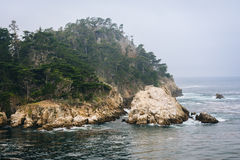 View of rocky bluffs and the Pacific Ocean, at Point Lobos State. Natural Reserve, in Carmel, California Stock Image