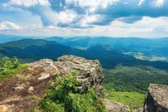 View from a rocky cliff in to the distant valley stock photo