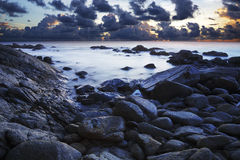 View of a rocky coast at dusk Stock Photography