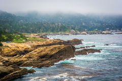 View of rocky coast and fog over distant hills at Point Lobos St Royalty Free Stock Photo