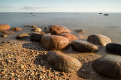 View of a rocky coast in the morning Stock Image