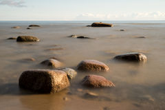 View of a rocky coast in the morning Royalty Free Stock Photos