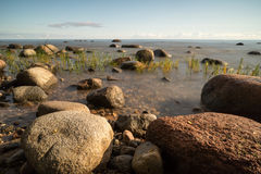 View of a rocky coast in the morning Stock Images