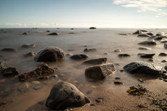 View of a rocky coast in the morning Stock Photos