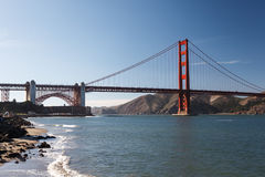 View from rocky coastline across Bay to Golden Gate Bridge Royalty Free Stock Photography
