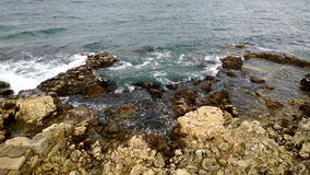 A view of the rocky coastline. Many waves Royalty Free Stock Image