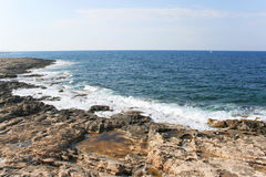 View of the rocky coastline near St. Julian`s.  Royalty Free Stock Photo