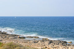 View of the rocky coastline near St. Julian`s.  Stock Photo
