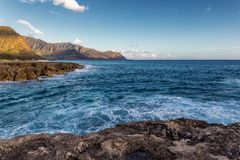 View of rocky coastline in warm evening sunlight, Oahu island. Hawaii stock photo