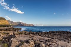 View of rocky coastline in warm evening sunlight, Oahu island. Hawaii royalty free stock photography