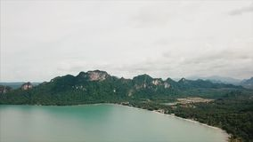 View of the rocky islands in Andaman sea, Thailand. Video. Aerial view on Tropical beach, Similan Islands, Andaman Sea. View of the rocky islands in Andaman sea stock video footage