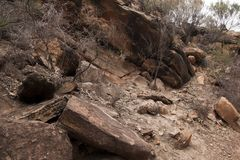 View of a rocky overhang at top of hill royalty free stock photo
