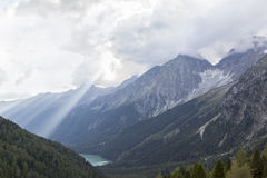 View of rocky peaks and lake in mountain valley. Royalty Free Stock Photography