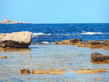 A view of a rocky shore of Sicily island Stock Photos