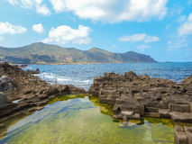 A view of a rocky shore of  Sicily island Stock Images