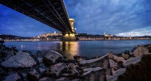 View of Rocky Shore Under Bridge Royalty Free Stock Image