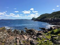 A view of the rocky shoreline along the east coast trail the vast Atlantic while hiking outside of St. John's, Newfoundland a. A view of the rocky stock images