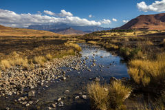 View of Rocky Stream surrounded by dry mountainous Landscape Royalty Free Stock Photos