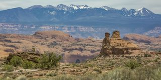 View of rocky terrain and La Sal Mountain in Moab royalty free stock photography