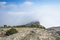 View from the rocky top of the mountain above the clouds Royalty Free Stock Images