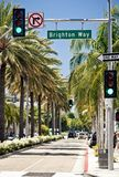 View of Rodeo Drive in Los Angeles. BEVERLY HILLS, USA - JULY 17: View of Rodeo Drive during sunny day. Rodeo Drive of Beverly Hills is a shopping district Stock Image