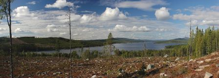 View From Roeknoelen Slope. Panoramic view from a slope of Roeknoelen over Hoeljessjoen, Vaermland, Sweden Royalty Free Stock Photos