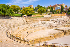 View of roman amphitheater against modern houses in Tarragona, in Spain Royalty Free Stock Photo