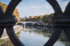 View of a Roman bridge over the Fiume Tevere in Rome. Italy stock photography