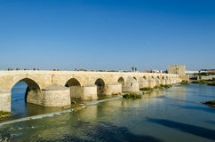 View of the Roman bridge and the river Guadalquivir, Spain. View of the Roman bridge over the Guadalquivir river, going into the distance, October 2016, Cordoba Royalty Free Stock Images