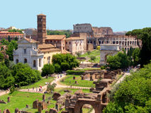 View of the Roman Forum. A panoramic view of the Roman Forum from Palatine Hill. The ancient ruins are seen in the foreground and the Colosseum in the background Stock Photography