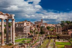 Roman Forum ancient ruins. View of the Roman Forum ancient monuments and Coliseum from Capitoline Hill in Rome Royalty Free Stock Photo
