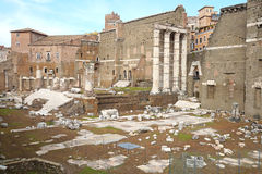 View of Roman Forum, focus on the Saturn`s Temple in foreground. Ancient ruins in Rome, Italy. Royalty Free Stock Images