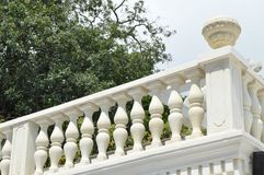 View of the romantic white balcony, terrace with balusters, white stone railing.  royalty free stock photography