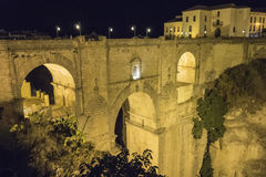 View of Ronda old stone bridge at night, Malaga, Spain Royalty Free Stock Photos