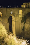 View of Ronda old stone bridge at night, Malaga, Spain Royalty Free Stock Photography