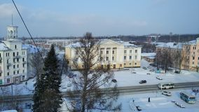View from the roof of the Siberian snow-covered city on the old house of culture royalty free stock photography