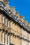 View of the roofline along Milsom Street south west side, Bath, England. With blue skies royalty free stock image