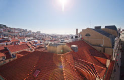 A view of the roofs of the houses. View from above. Panorama of the city. The city of Porto in Portugal. Observation deck. Red tile. The flow of light to the Stock Photo