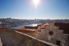 A view of the roofs of the houses. View from above. Panorama of the city. The city of Porto in Portugal. Observation deck. Red tile. The flow of light to the Royalty Free Stock Images