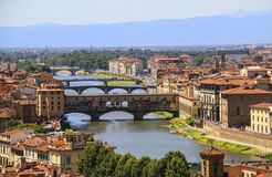 View of the roofs of houses of Florence, the Arno River and brid Royalty Free Stock Photography