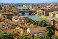 View of the roofs of houses of Florence, the Arno River and brid Royalty Free Stock Images