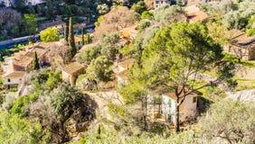 Rustic old village Esporles in mediterranean landscape, Majorca island. View of roofs of mediterranean village Esporles on Mallorca, Spain stock images