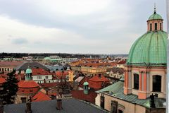 View of the roofs of old Prague from the side of a Catholic cathedral. royalty free stock image
