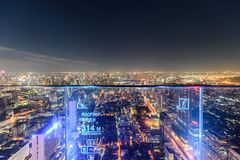 View of rooftop with buildings illumination and traffic light in Bangkok. Bangkok, Thailand - Dec 14 2018 : View of rooftop with buildings illumination and stock image