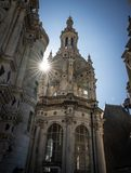 View of rooftop tower of Chateau Chambord with sun peeking through. stock photos