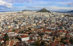View of the rooftops of Athens with their interesting patios and roof gardens looking north over Thiseio toward Mount Lycabettus p royalty free stock photo